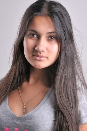 girl Nayana, years old with  eyes and  hair.