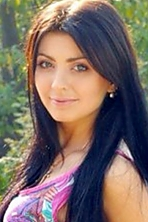 Ukrainian girl Tatiana,23 years old with blue eyes and black hair.