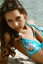 Ukrainian girl Veronika,36 years old with grey eyes and black hair.