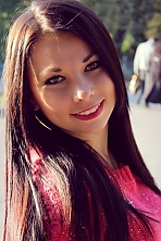Ukrainian girl Taisia,20 years old with green eyes and black hair.