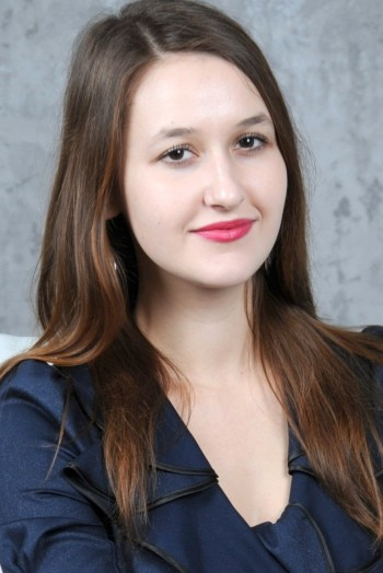 Ukrainian girl Vika,20 years old with brown eyes and light brown hair.