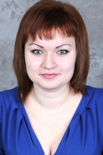 Ukrainian girl Oksana,26 years old with black eyes and dark brown hair.