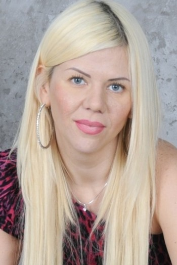 Ukrainian girl Irina,38 years old with brown eyes and blonde hair.