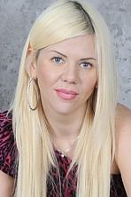 Ukrainian girl Irina,38 years old with brown eyes and blonde hair.