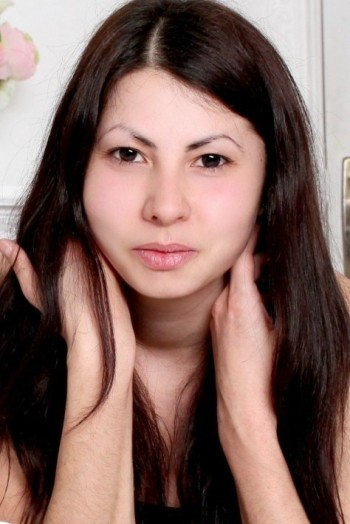 Ukrainian girl Masha,27 years old with brown eyes and light brown hair.