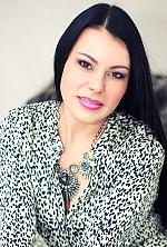 Ukrainian girl Natalia,42 years old with brown eyes and black hair.