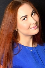 Ukrainian girl Daria ,21 years old with green eyes and red hair.