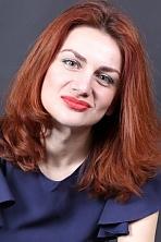 Ukrainian girl Zoya,38 years old with green eyes and auburn hair.