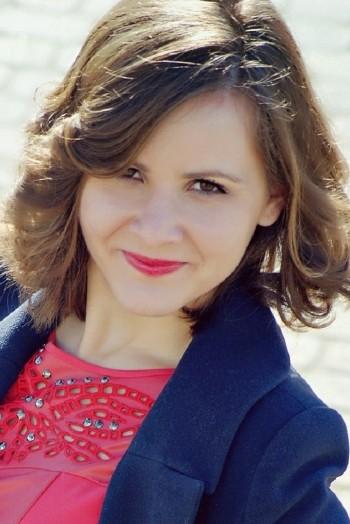 Ukrainian girl Inna ,21 years old with brown eyes and dark brown hair.