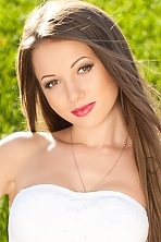 Ukrainian girl Tanya,19 years old with brown eyes and dark brown hair.