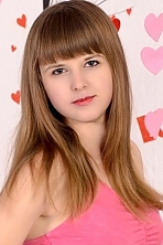Ukrainian girl Angela,22 years old with grey eyes and light brown hair.