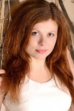 Ukrainian girl Julia,25 years old with green eyes and red hair.
