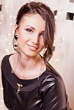 Ukrainian girl Valentina,21 years old with grey eyes and dark brown hair.