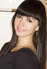 Ukrainian girl Alexandra,23 years old with brown eyes and black hair.