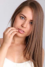Ukrainian girl Victoria,20 years old with blue eyes and light brown hair.