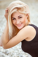 Russian girl Anna,29 years old with green eyes and blonde hair.