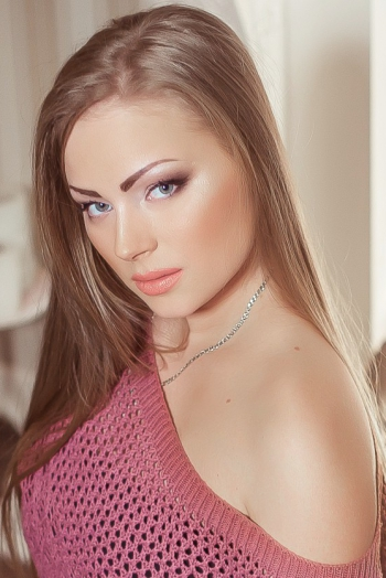 Ukrainian girl Maria,22 years old with green eyes and blonde hair.