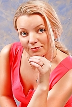 Ukrainian girl Alena,40 years old with blue eyes and blonde hair.