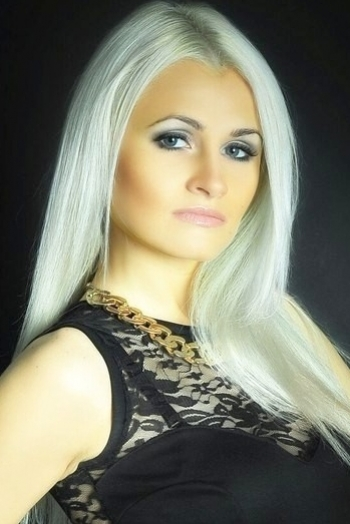 Ukrainian girl Alina,28 years old with blue eyes and blonde hair.