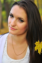 Ukrainian girl Helen,23 years old with green eyes and dark brown hair.