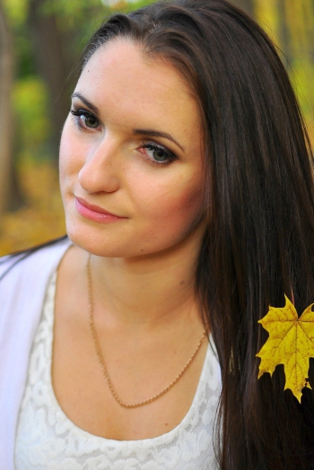 Ukrainian girl Helen,23 years old with green eyes and dark brown hair.