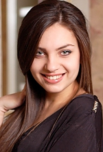 Ukrainian girl Violetta,21 years old with green eyes and dark brown hair.