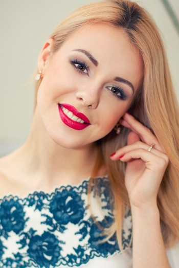 Ukrainian girl Christina,22 years old with brown eyes and blonde hair.