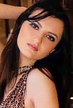 Ukrainian girl Julia,25 years old with black eyes and dark brown hair.