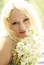 Ukrainian girl Anna,38 years old with blue eyes and blonde hair.