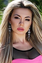 Ukrainian girl Marina,20 years old with brown eyes and blonde hair.