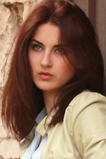 girl Karinochka, years old with  eyes and  hair.