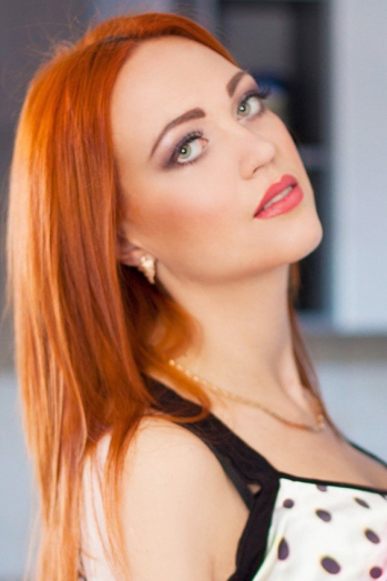 Ukrainian girl Yana,28 years old with green eyes and red hair.