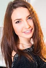 Ukrainian girl Nina,21 years old with brown eyes and dark brown hair.