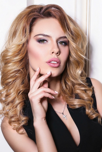 Ukrainian girl Victoria,24 years old with brown eyes and blonde hair.