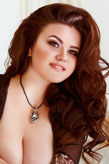 Ukrainian girl Anna,28 years old with brown eyes and light brown hair.
