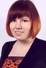 Ukrainian girl Inna,21 years old with grey eyes and red hair.