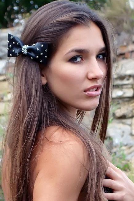 Ukrainian girl Juliya,25 years old with grey eyes and dark brown hair.
