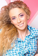Ukrainian girl Alena,21 years old with blue eyes and blonde hair.