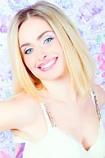 Ukrainian girl Lyudmila,32 years old with blue eyes and blonde hair.