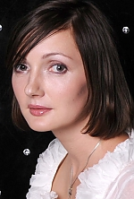 Ukrainian girl Svetlana,35 years old with brown eyes and dark brown hair.