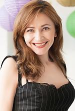 Ukrainian girl Tatiana,42 years old with blue eyes and light brown hair.