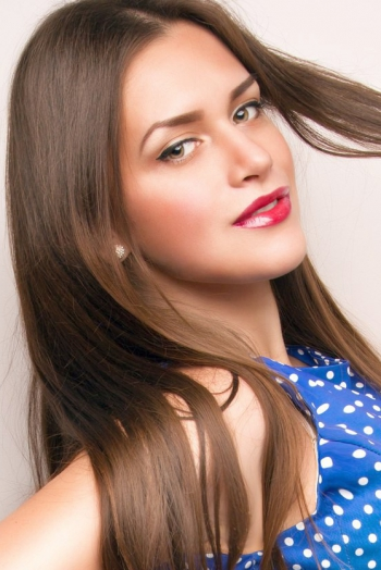 Russian girl Maria,22 years old with green eyes and light brown hair.