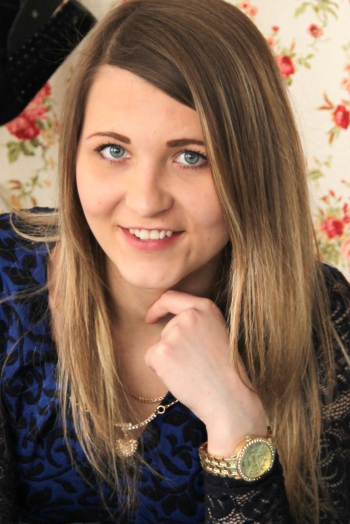 Ukrainian girl Lolita,22 years old with blue eyes and light brown hair.