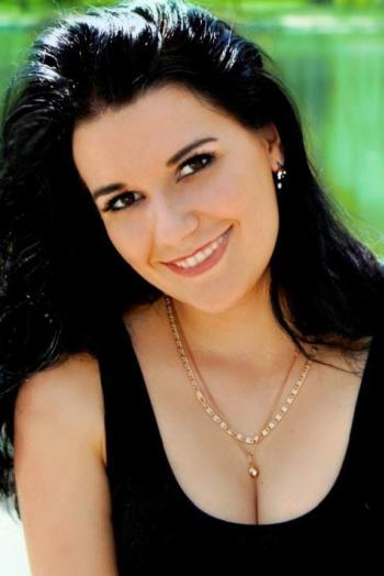 Ukrainian girl Olga,28 years old with brown eyes and black hair.