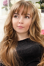 Ukrainian girl Anna,28 years old with green eyes and light brown hair.