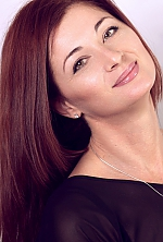 Ukrainian girl Oksana,45 years old with green eyes and red hair.