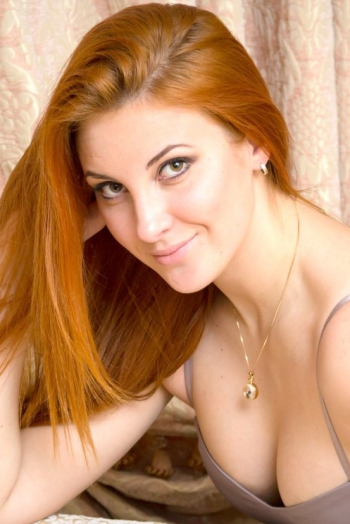 Ukrainian girl Lilia,25 years old with brown eyes and red hair.