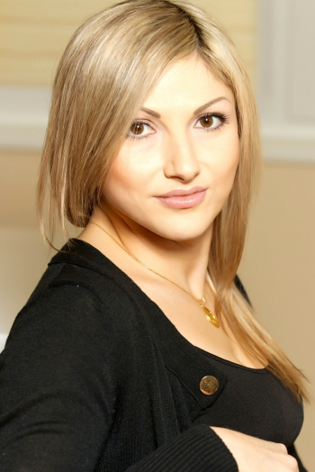 Ukrainian girl Nataliy,34 years old with brown eyes and light brown hair.