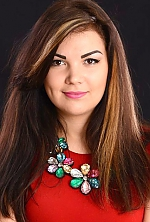 Ukrainian girl Anna,23 years old with brown eyes and dark brown hair.