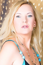 Ukrainian girl Janet,40 years old with blue eyes and blonde hair.